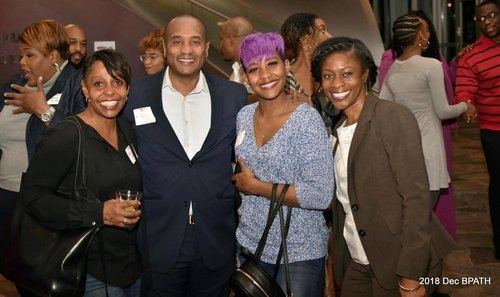 People smiling for the camera at a Black Professionals event.